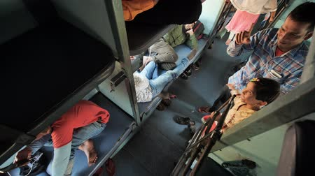 inside of train : Agra, India - December 12, 2018: Indian train and economy class carriage inside with passengers.