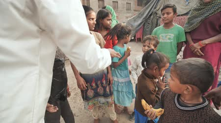 deprived : Agra, India - December 12, 2018: Banana treats for children from poor areas of Agra city.