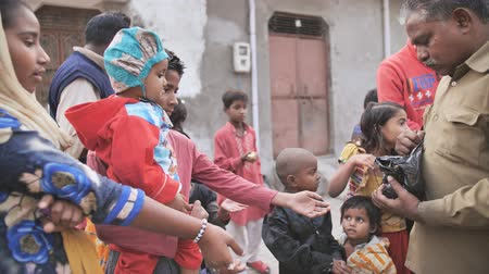 third world : Agra, India - December 12, 2018: Banana treats for children from poor areas of Agra city.