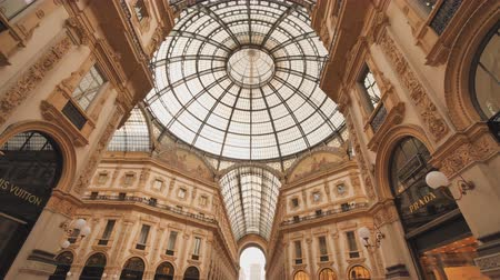 milan fashion : Milan, Italy - August 11, 2018: Shopping art gallery in Milan. Galleria Vittorio Emanuele II, Italy. Stock Footage