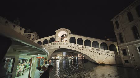 Venice, Italy - August 5, 2018: Video in motion from the boat through the night channels of Venice.