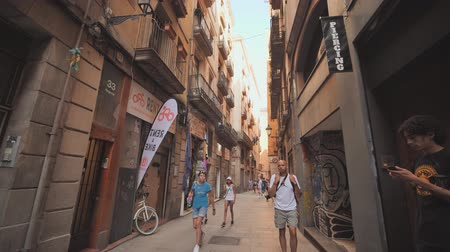 Barcelona, Spain - August 5, 2018: Old streets of Barrio Gotico in Barcelona, Catalonia. It is centre of old city of Barcelona. Center of touristic life.
