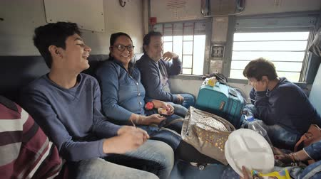crowded : Mumbai, India - December 17, 2018: An Indian family travels in an economy class train. Stock Footage