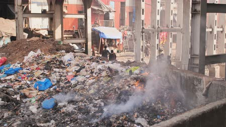 Mumbai, India - December 17, 2018: Burning landfill in Dharwai slums.