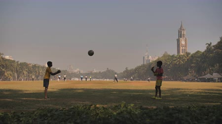 maidan : Mumbai, India - December 17, 2018: Children throw the ball to each other at Oval Maidan in Mumbai. India. Stock Footage