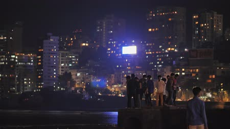 Mumbai, India - December 17, 2018: City beach Chowpatty of Mumbai in the evening with people.