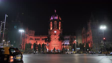 viktoriánus : Mumbai, India - December 17, 2018: Chatrapati Shivaji Terminus earlier known as Victoria Terminus in Mumbai, India. Ninght panorama Stock mozgókép