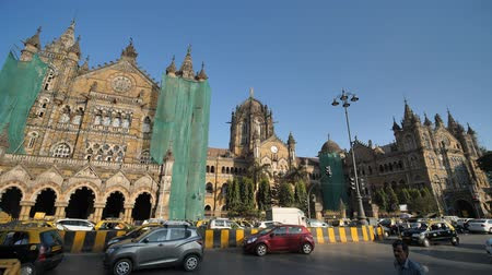 cars traffic : Mumbai, India - December 17, 2018: Chhatrapati Shivaji Terminus CST is a UNESCO World Heritage Site and an historic railway station in Mumbai, India