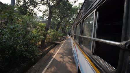 Goa, India - December 12, 2018: The view from the window of an intercity bus in India. State of Goa.