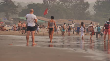 hippie : Goa, India - December 12, 2018: Arambol beach in Goa with tourists. Stock Footage