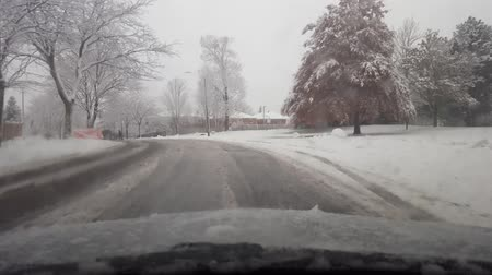 banliyö : Driving Through Snowy Suburb in Daytime.  Driver Front Point of View While Snowing.  Fresh Snow Drive POV.