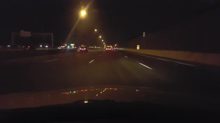 Észak amerika : Driving on Highway at Night.  Driver Point of View POV.  Interstate or Freeway or Expressway or Turnpike. Stock mozgókép