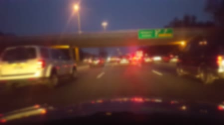 államközi : Driving Through Heavy Traffic Jam on Highway at Night.  Driver Point of View POV.  Interstate or Freeway or Expressway or Turnpike. Stock mozgókép