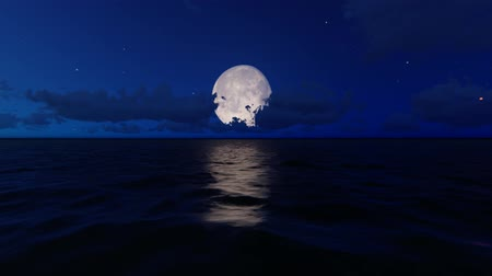 Full Moon over the sea and clouds in background