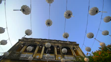 hoi an : traditional Vietnamese lanterns hanging over a street