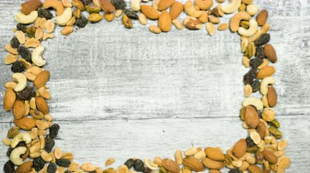 cukrozott : Healthy type of nuts and sweet on wooden background. Dry healthy snack food