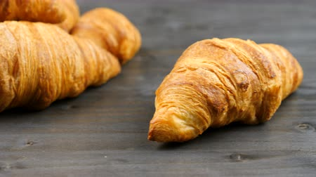 kruvasan : Delicious croissants on a piece of old wood in studio