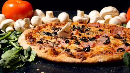 pieprz : Slow motion dolly shot on cutted mushrooms falling on delicious homemade pizza