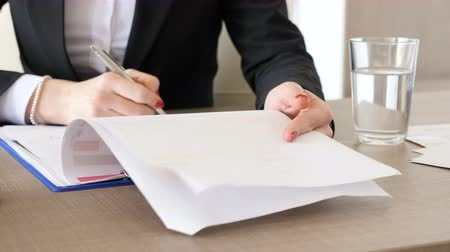 conference table : Businesswoman at her desk checking documents with charts on them. Corporate lifestyle Stock Footage
