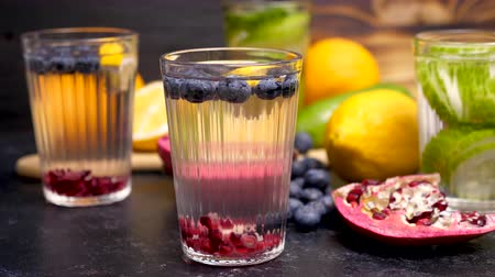 infused water : Water with infused blueberries, pomegranate and lemon. Fresh homemade detox. Parallax dolly footage