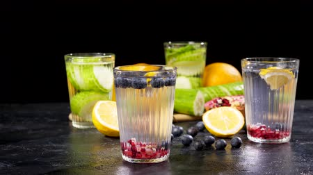 infused water : Homemade fresh detox water made of berries, pomegranate and lemons and other is made of cucumbers