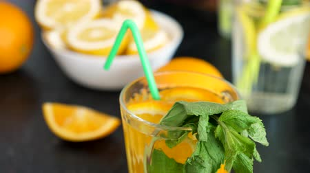 infused water : Orangeade water drink with mint. Close up topview dolly footage Stock Footage