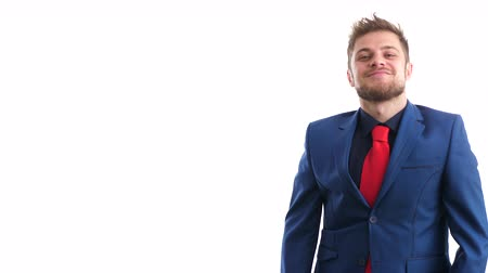 fool : Young businessman makes silly faces in studio. Shot over white background. Slow motion footage. 4K video