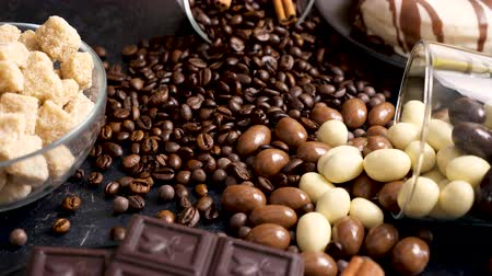 арахис : Overturned glass with coffee beans and peanuts in chocolate on a wooden background