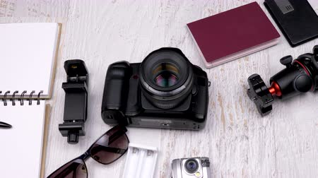 pas : Travel photographer camera and other accessories on wooden background Dostupné videozáznamy