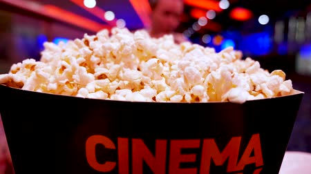 arejado : Pop corn in carton box with cinema word written on it in cinema hall