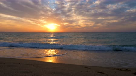 settings : Scenic sunrise over the sea on the beach. Beautiful landscape. Travel and vacation