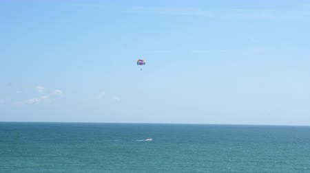 vocacion : Two people parasailing over the sea. General view. Active vacation.
