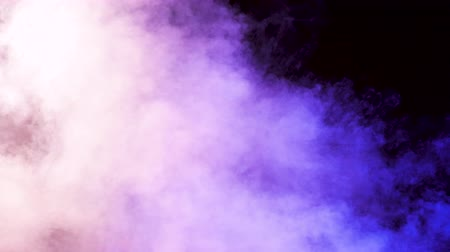 a form : Colored smoke over a black background in studio. 4K footage Stock Footage