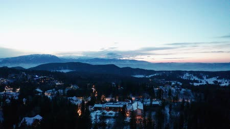 jodła : Aerial view of sunset over the mountains in winter Wideo
