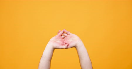 спрос : Hands making different silly signs isolated on yellow orange background in studio Стоковые видеозаписи