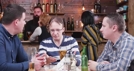 pint glass : Male friends in vintage pub drinking beer and having a good time