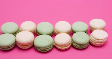macarons : Delicious and fresh macaroons on pink background in studio