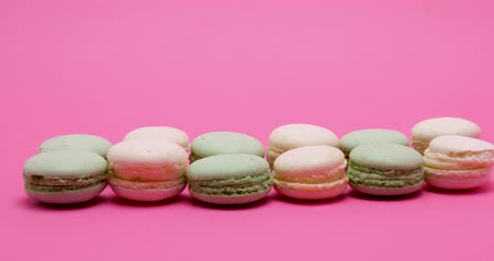macarons : Sweet delicious macaroons dessert on pink background in studio Stock Footage