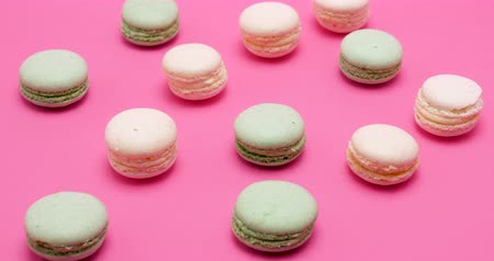 macarons : Green and cream macarons dessert on pink background