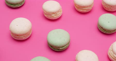macarons : Multiple sweet colored macaroons on pink background