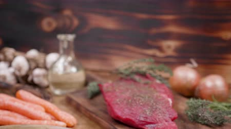 schab : Beautiful composition of raw meat and vegetables on a dark wooden background. Wooden vintage style surface.