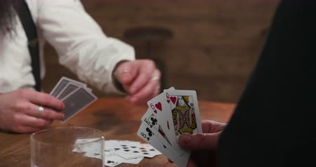 bourbon whisky : Card game in a pub, hands of two males