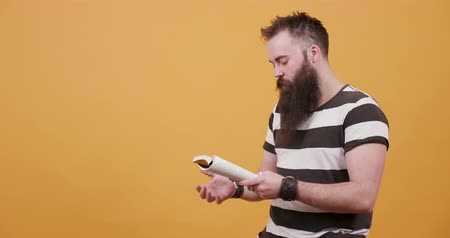 sincerely : Man with long facial hair reads a book and arranges his beard