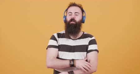 sincerely : Bearded young hipster listening to music and enjoying it Stock Footage