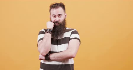 seducing : Bearded young handsome man being seduced, bites his fist Stock Footage