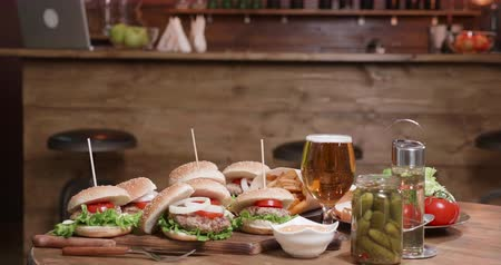 american cuisine : Appetizing burgers on a table in a small pub