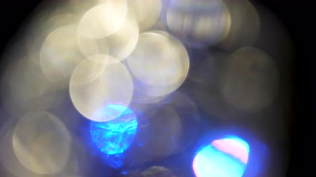 iluminado para trás : Abstract colored game of light reflections and motion. Slowly changing colours. Light circles covering the frame. Amazing visual effect. Stock Footage