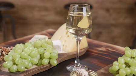 camembert : Rotating composition of cheese served with a glass of wine and grapes