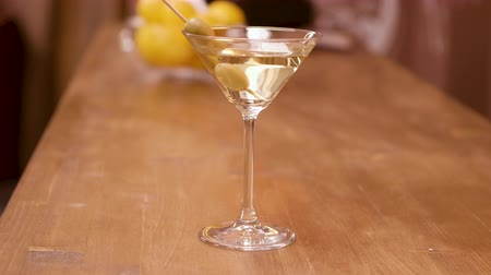 vermouth : Parallax shot of a martini glass on a bar counter Stock Footage