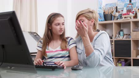 role model : Young girl is confused with her homework and her parent tries to help. Responsible parenting concept.